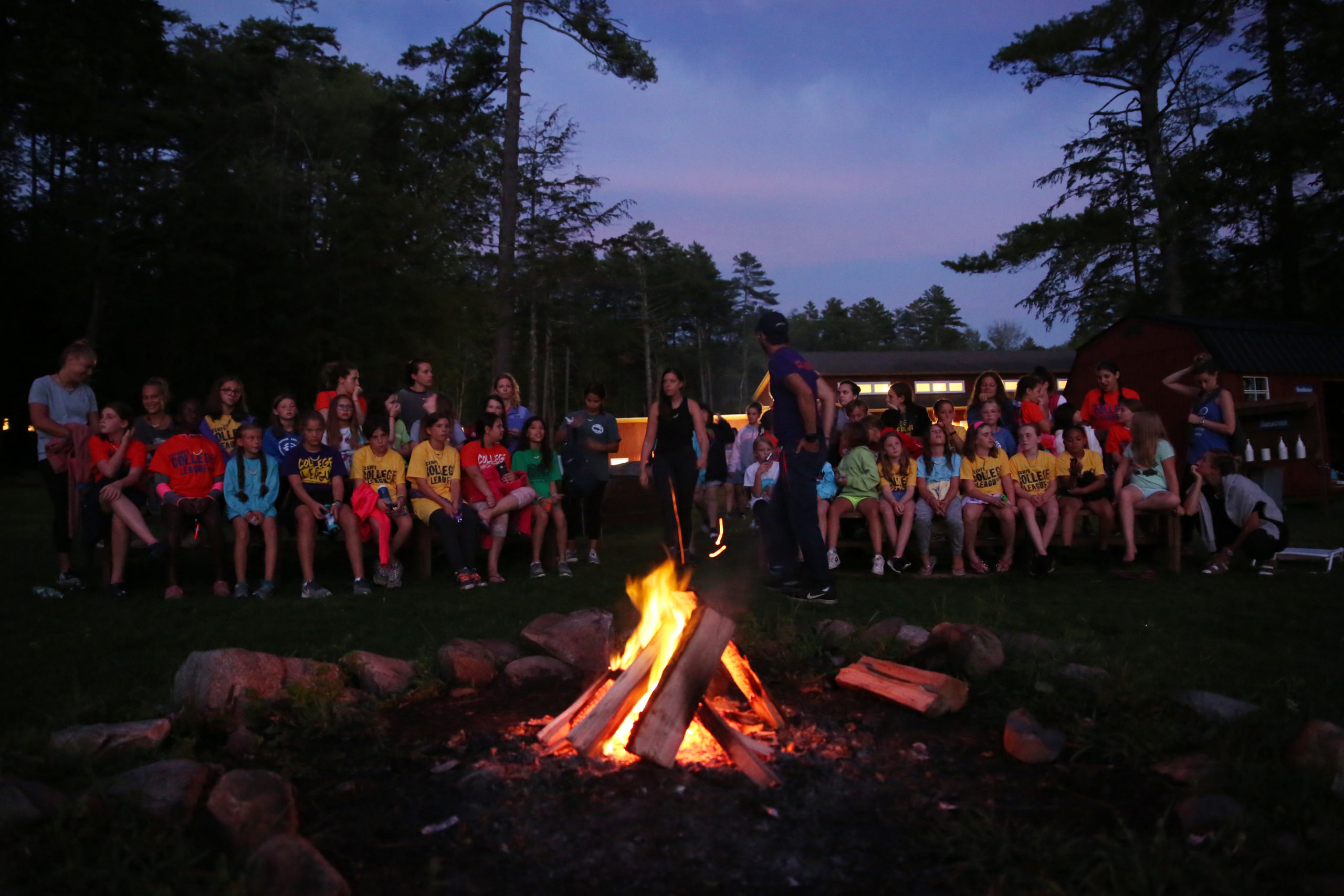 Campers and volunteers around a campfire