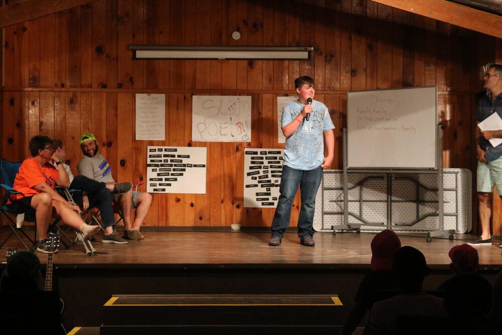 Carter giving a presentation at camp.