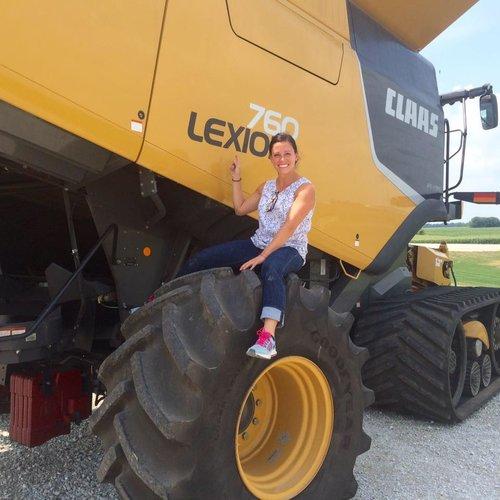 Lexie on a digger