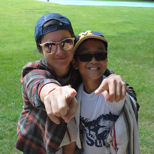 Jesse with a camper at Experience Camps
