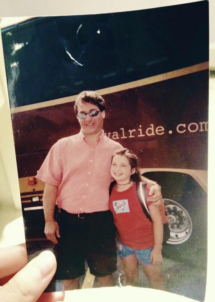 Julia and her dad in front of a bus