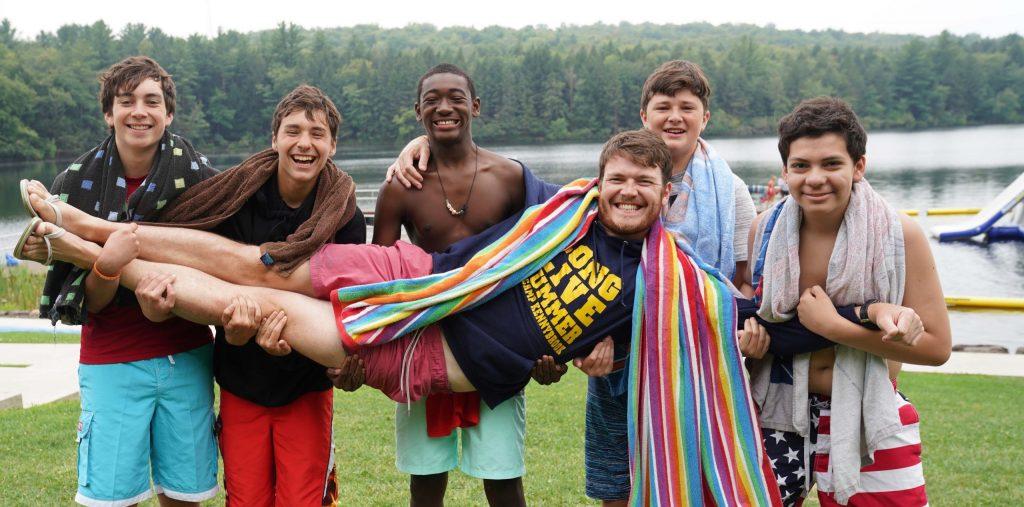 Matt being held by campers